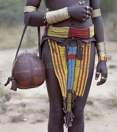Africa | A close-up of a beautifully decorated leather apron and other adornments worn by a Bena girl. | ©John Warburton-Lee/Nigel Pavitt