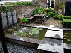 Small Dutch garden with a very nice water feature