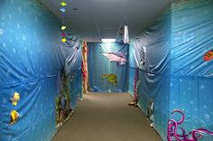 Do a hall decorating spirit contest for Halloween? Could do one hallway underwater and the other a jungle theme????