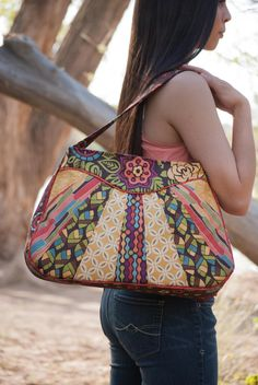 The Sunburst Sling is a great bag to experiment with different combinations of fabric, or to showcase your favorite designers latest fabric collection! Each step is thoroughly explained and Ive included computer drawn illustrations of the steps. The pattern includes instructions for