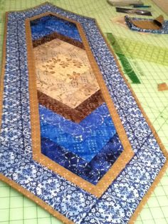 """Table runner for winter. This is a quilt as you go pattern called """"Braid Runner""""."""