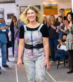 Designer Stina Andersen takes her walk down the runway at the conclusion of Paint a Dress for Success Event and Atelier Fashion Show in The River Arts District.