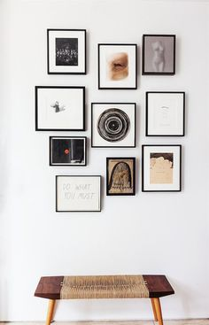Above A Wabi Sabi Style Bench Gallery Wall Of Small Scale Art Tied Together By The Black Frames Lies Just Inside Entry