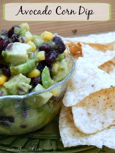 Num's the Word:  We are huge fans of dip and salsas and this Avocado Corn Dip is one of our favorites!  It takes minutes to toss together and is oh so yummy!