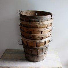 Wooden bushel baskets. my dad was a great gardener... we ate fresh vegetables all summer and enjoyed the pickled/frozen/canned harvest for the rest of the year.