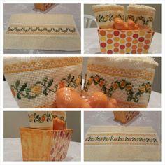 Maceta rectangular con decoupage, dos toallas de mano amarillas bordadas en punto cruz con flores en tonos naranja.