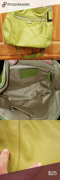 Coach crossbody/shoulder bag Pea green.  Crossbody or shoulder bag.  Crossbody strap is adjustable and removeable.  Interior is clean.  No signs of wear on handles.  A couple small marks on front zipper pocket.  And a small scratch to the left of pocket Coach Bags Crossbody Bags