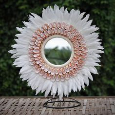 Browm and Cream Papua Shell and Feather Circle Decoration on stand Diy Crafts To Sell On Etsy, Diy Home Crafts, Mirror Crafts, Diy Mirror, Paper Flower Wall, Flower Wall Decor, Deco Bobo, Feather Wall Art, Juju Hat
