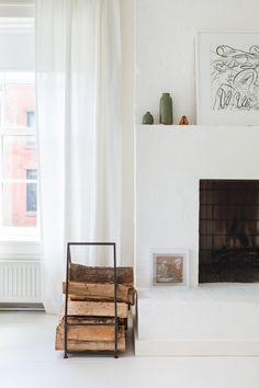 All white fireplace and mantel creates clean modern feel