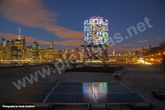 http://www.plexiglas.net/product/plexiglas/en/references/roof-facade/Pages/water%20tower.aspx A farsighted work of art in New York:  made of over 1000 pieces of brightly colored PLEXIGLAS®, Tom Fruin's Watertower is perched on the roof of the headquarters for Brooklyn Bridge Park.
