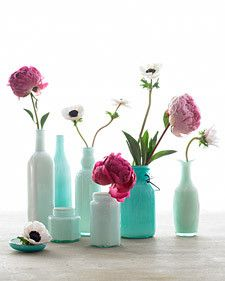 Pink flowers in combination with blue bottles