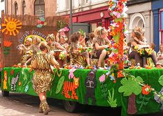St. Mary's Primary school had this George in the Jungle inspired float with animal print costumes and a frieze of animals around the skirt. A pack of various animals followed behind.     via WhiteHaven Carnival 2008