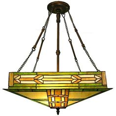 Stained glass home decor is elegant, trendy and timeless.  As evidence of this just look around you.  Many beautiful homes use a combination of stained glass wall decor, stained glass wall hangings and stained glass accent lights to create a vibe that is the epitome of beautiful, relaxing and inviting.    Tiffany-style Mission Ceiling Fixture