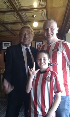 Robert Plant with some local futbol (football) fans...