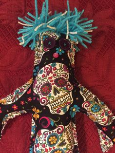 A personal favorite from my Etsy shop https://www.etsy.com/listing/246028885/sugar-skull-stress-doll-day-of-the-dawn