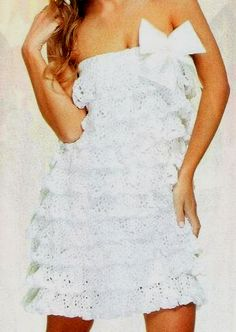 Pretty White Dress with Frills free crochet pattern-site calls it a knitted dress but it is crochet-pattern not detailed but and intermediate/advanced crocheter can probably figure it out