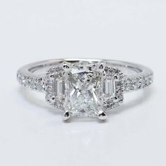 Custom Three Stone Halo Ring in White Gold https://www.brilliance.com/recently-purchased-rings/custom-three-stone-halo-ring-white-gold