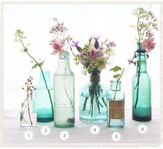 I love these blue glass vases - less flowers, more glass...