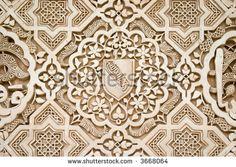 Detail of Islamic (Moorish) plasterwork and tile-work at the Alhambra, Granada, Spain.