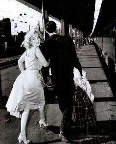Marilyn and Arthur dash to a waiting train at Washington, D.C.'s Union Station on May 23, 1957