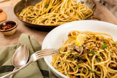 This traditional Sicilian dish makes a festive main course, especially when served from a giant platter Sweet and savory flavors mingle beautifully here, with currants, raisins, saffron and pine nuts Aromatic wild fennel fronds and fresh sardines are preferred, but even if made with cultivated fennel and canned sardines, this is a magnificent dish
