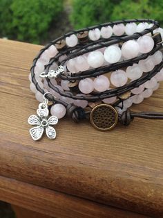 Buy LOVE Mala OM Unearth Your Heart Chakra Yoga Bracelet Quartz 4 Leather Wrap bracelet Flower Charm by elementcandles. Explore more products on http://elementcandles.etsy.com