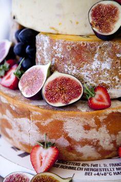 Cheese wedding cake. Summer Fete wedding.English marquee wedding photography by www.ashdownweddingphotography.co.uk