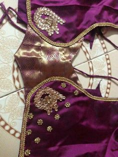 Purple color silk designer blouse with short sleeves and maggam, chain work embellished peacocks adorned around the back side of the. Silk Saree Blouse Designs, Saree Blouse Patterns, Designer Blouse Patterns, Blouse Neck Designs, Stone Work Blouse, Blouse Desings, Patch Work Blouse Designs, Blouse Models, Shilpa Shetty