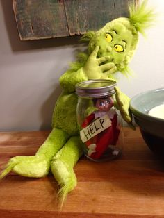 The Grinch caught the Elf on the shelf and put him in a jar