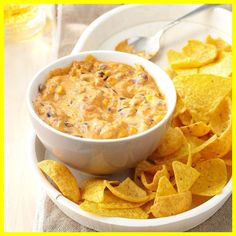 Corn Chip Chili Cheese Dip- From taco dip to spinach dip, these potluck dip recipes are ready to party. Find 25 crowd-pleasing dip recipes perfect for game day or potluck gatherings. Tell guests to dig in—each recipe serves 12 or more! Chili Cheese Dips, Cheese Dip Recipes, Beer Cheese, Milk Recipes, Goat Cheese, Appetizer Dips, Appetizer Recipes, Slow Cooker Recipes, Cooking Recipes