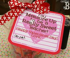 """""""You Measure Up to be a Really Sweet Teacher!"""" Valentine gifts.  Treat inside a measuring cup {Target has some cute heart shaped ones in pink and red} - super easy and fast!  Printable tag here :)"""