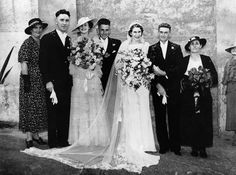 1938 wedding. Huge bouquets!