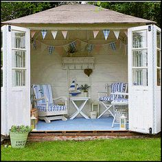 garden shed with pennant banner and accordion doors.