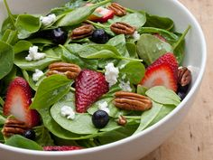 Baby Spinach with Fresh Berries, Pecans and Goat Cheese in Raspberry Vinaigrette. I could eat salads like this (fruit, nuts, goat cheese, spinach or arugula, sweet dressing) everyday.