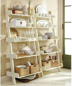 Studio Wall Shelf  Minimally invasive, this bookshelf uses the height of the room without taking too much space.  From Houzz   Pottery Barn