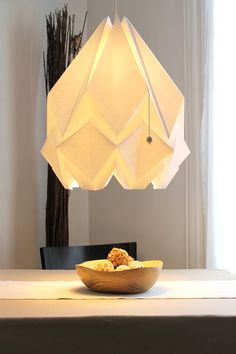 HANAHI (a flower in Japanese) is a handmade lamp shade made in high quality paper using the ancient Japanese paper folding method Origami, designed and carefull