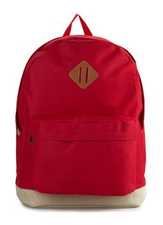 Basic Backpack by Tucked In in red. Made of canvas material.