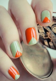 Pretty orange olive french manicure nails.