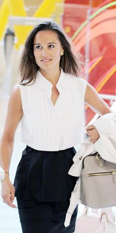 MAY 15, 2011 The stylish traveler was out and about in Madrid wearing a sleeveless white blouse tucked into a black peplum skirt.