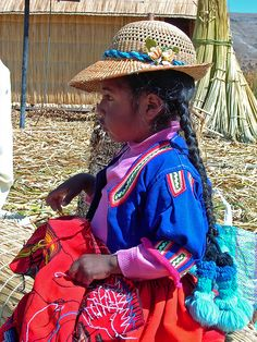 Uros Child by rodmack, via Flickr. We went to Lake Titicaca in Peru.  The Uros people live on the floating reed islands, should be one of the wonders of the world.