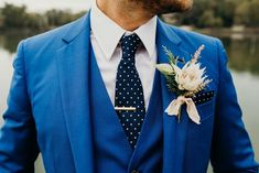 Vibrant blue wedding suit with navy polka dot tie | Image by Cork Creative