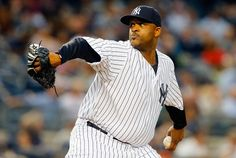 CC Sabathia #52 of the New York Yankees pitches in the second inning against the Miami Marlins at Yankee Stadium on June 18, 2015 in the Bronx borough of New York City. (June 17, 2015 - Source: Jim McIsaac/Getty Images North America)