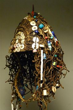Africa | A ceremonial hat from the Lega people of DR Congo | Fiber, glass beads, buttons and shells