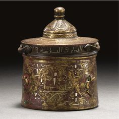 A SILVER-INLAID BRONZE INKWELL AND COVER, KHURASAN, 12TH-13TH CENTURY