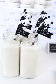 Milk and panda straws from a chic Party Like a Panda Birthday Party at Kara's Party Ideas. See this monochromatic party and more at karaspartyideas.com!