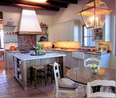 saltillo tile floors/creamy gray cabinets