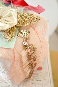 Pretty, feminine wrappings - pink crepe paper and gold sequins.