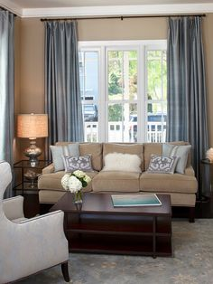 , Traditional Living Room With Cool Blue Bedroom Curtain Ideas Also Conventional Windows Design With Light Brown Sofa Color Also Modern Brown Coffee Table Also White Armchair Also Occasional Table Glass Countertop: Considerations in Choosing Bedroom Curtain Ideas