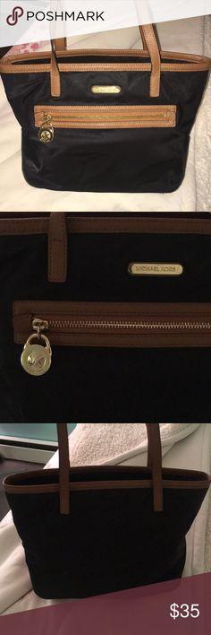 MICHAEL KORS nylon tote Michael KORS black nylon tote - wear on bottom corners and straps (shown)  No stains or tears - only slight wear KORS Michael Kors Bags Totes