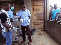 In this photo taken on Monday, Jan 12, 2015 Mozambique government officials gather evidence around a house that was allegedly used to make local beer that made people sick with 72 fatalities in Tete province, Mozambique. (AP Photo/Antonio Chimundo) ▼13Jan2015AP|Death toll rises to 72 from contaminated beer in Mozambique http://bigstory.ap.org/article/cf252c495de34b22b9d9b6387ca24105 #Tete_province_Mozambique